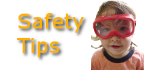 Picture of a child in safety goggles representing the safety tips section